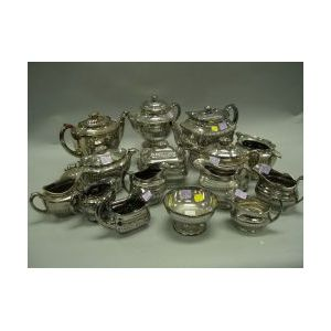 Fifteen Silver Lustre Ware Teapots, Sugars and Creamers.