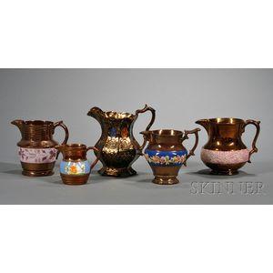 Five Copper Lustre Pottery Pitchers