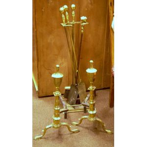 Pair of Brass Urn-top Andirons and Four Brass Fireplace Tools with a Stand.