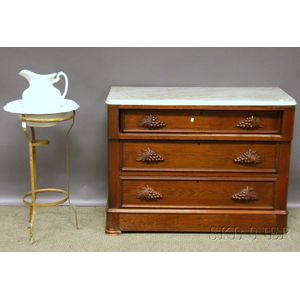 Victorian White Marble-top Carved Walnut Dresser and a White Ironstone Chamber Pitcher and Basin with Iron Stand.