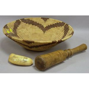 Scrimshaw Decorated Whales Tooth, a Tiger Maple Pestle, and a Native American Coiled Basket.