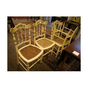 Set of Four Victorian Painted and Floral Decorated Caned-Seat Side Chairs.