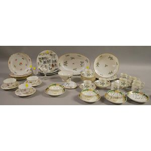 Four Partial Sets of Porcelain Tableware and Two Colorless Cut Glass Wine Glasses
