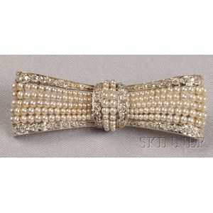 Edwardian Platinum, Diamond, and Seed Pearl Bow Brooch