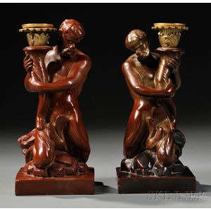 Pair of Wood and Caldwell Triton Candlesticks