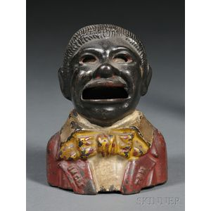 "Painted Cast Iron ""Uncle Tom"" Mechanical Bank"