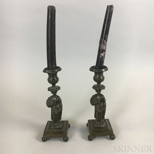 Pair of Weighted Bronze Figural Candlesticks