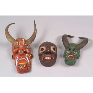 Three Polychrome Carved Wood Masks