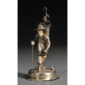 German Goldwashed Silver and Ivory-mounted Figure of a Man Harvesting Grapes