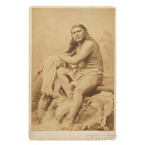 Framed Cabinet Card of an Indian Sitting on Animal Skins