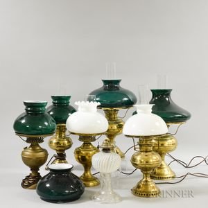 Six Brass Kerosene Lamps and a Pressed Glass Lamp.     Estimate $100-200
