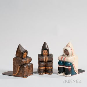 Pair of Carved Eskimo Bookends and a Single Carved and Painted Eskimo Bookend