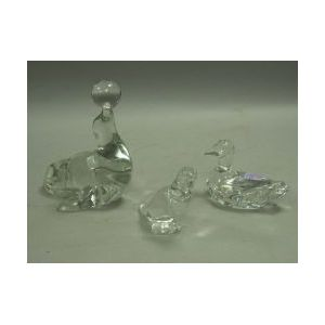 Baccarat Colorless Glass Duck and Parrot Figurals and a Colorless Glass Seal with Ball Figural.