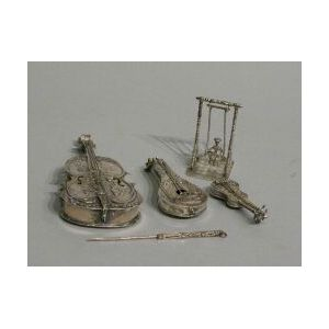 Three Miniature Stringed Instruments, a Whimsey and a Toothpick.
