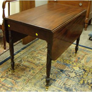 Late Federal Mahogany Drop-leaf Table with Acanthus Leaf Carved Legs.
