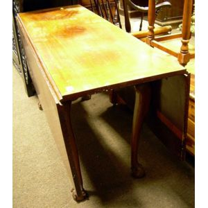 Chippendale Carved Mahogany Drop-leaf Dining Table.