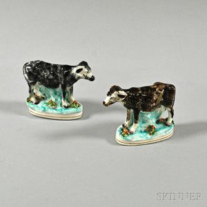 Pair of Staffordshire Cow and Steer Ceramic Figures