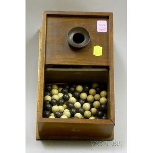 Walnut Voting Box with Approximately 150 Black and White Clay Voting Marbles.