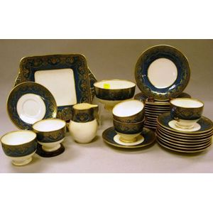 Thirty-one Piece Wedgwood Gilt and Lapis Banded Porcelain Dessert Set.