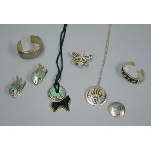Group of Eight Southwestern Silver Bracelets, Necklaces, and Pins