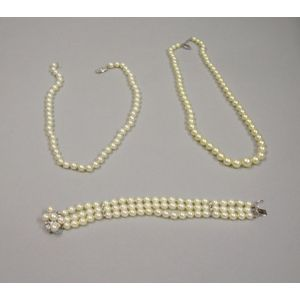 Two Single Strand Pearl Necklaces and a Triple Strand Pearl and Diamond Bracelet