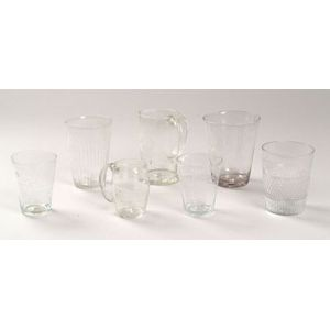 Seven Colorless Blown Glass Drinking Vessels
