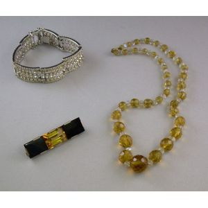 .800 Silver Citrine and Onyx Pin, a Faceted Glass Bead Necklace, and a Costume Paste Bracelet.