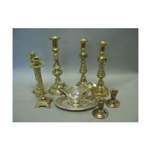 Two Pairs of Brass Candlesticks, a Silver Plated Gravy Boat, a Pair of Sterling Candleholders and a Brass Candlestick.