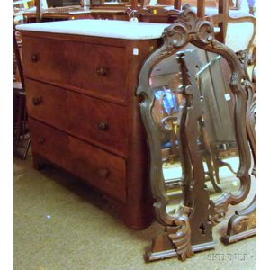 Victorian Rococo Revival Marble-top Carved Walnut and Mirrored Dresser.