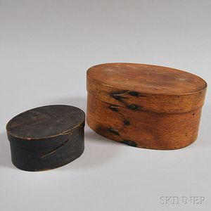 Two Oval Covered Boxes