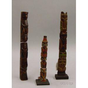 Three Northwest Polychrome Totem Poles