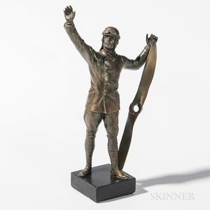Cast Bronze Statuette of an Aviator Holding a Propeller