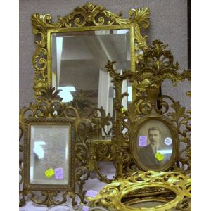 Eight Assorted Gilt Cast Brass and Metal Table Frames and a Mirrored Sconce.