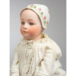 "Gebruder Heubach ""Baby Stuart"" with Molded Bonnet"