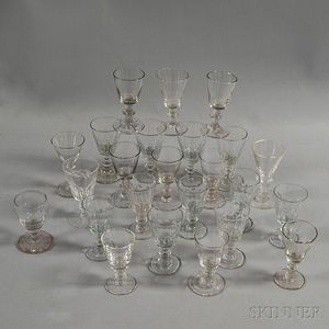 Twenty-four Molded Colorless Glass Cordials