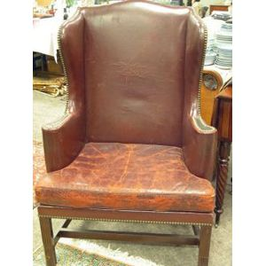 Chippendale-style Leather Upholstered Mahogany Wing Chair.