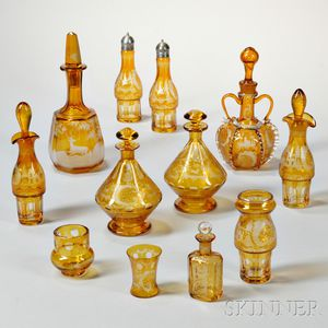 Twelve Pieces of Amber Etched Bohemian Glass Tableware