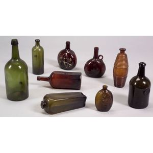 Nine Blown Colored Glass Bottles