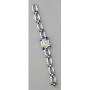 Platinum, Sapphire, and Diamond Wristwatch, Cartier