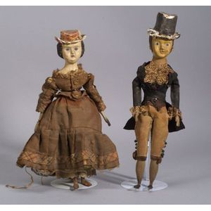 Pair of Painted Papier-mache and Carved Wood Dolls