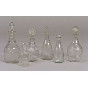 Five Colorless Glass Decanters and a Cruet