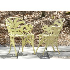 Two Yellow-painted Cast Iron Fern Pattern Garden Armchairs