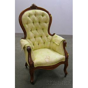 Victorian Rococo Revival Upholstered Carved Walnut Parlor Armchair.