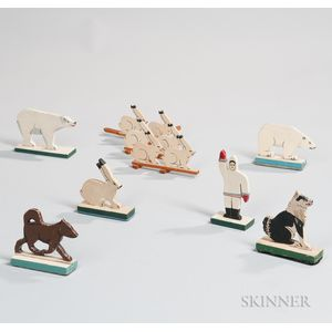 Seven Carved and Painted Animal and Human Figures