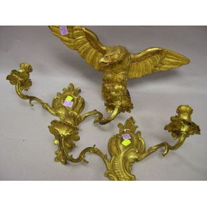 Small Carved Giltwood Eagle and a Pair of Rococo-style Gilt Cast Brass Two-Arm Wall Sconces.