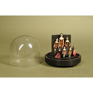 Eight Small Peg Wood Dolls in Dome