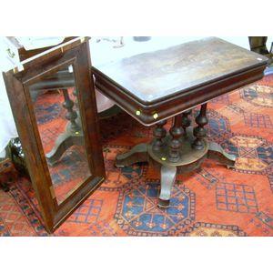 Empire Mahogany and Mahogany Veneer Pedestal-base Card Table and an Ogee Mirror.