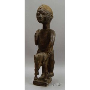 African Figure on Animal