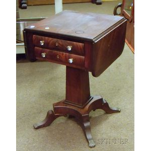 Empire-style Carved Mahogany and Mahogany Veneer Drop-leaf Two-Drawer Pedestal-base Work Table.