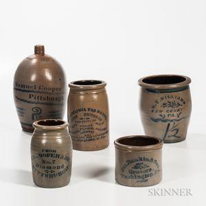 Five Cobalt-decorated Pennsylvania Stoneware Advertising Vessels